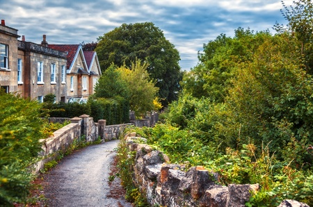 old english: typical old English  village by evening Stock Photo