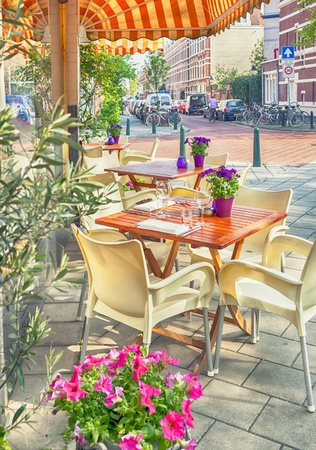 summer dutch street cafe with flower pots photo
