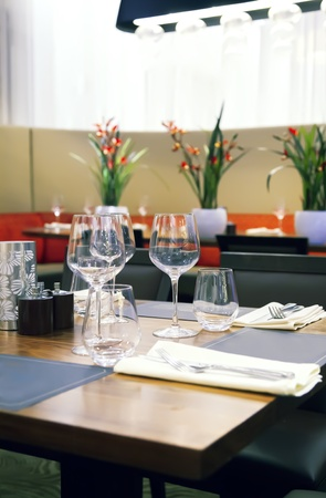 glasses on table in modern restaurant  photo