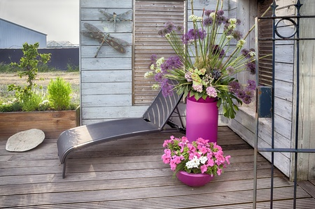 evening by home terrace with flowers pots photo