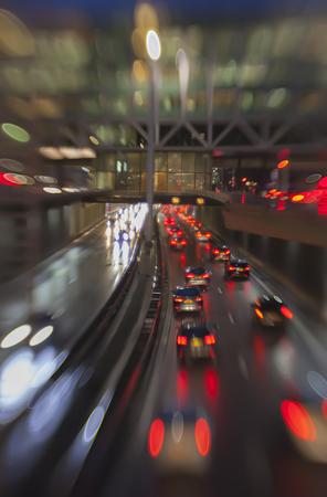 evening traffic light in rain city  photo