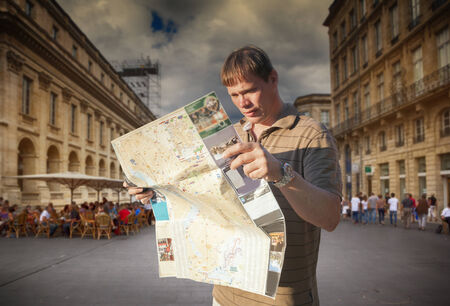 tourist with map in Bordeaux city photo