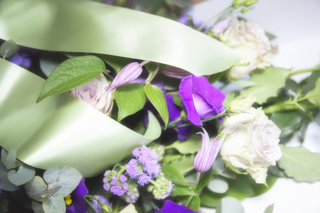 flower arrangement  for funeral with satin ribbons Stock Photo