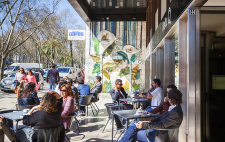 people in cafe at Avenida da Liberdade, main street of  Lisbon, Portugal ,  mart 2014