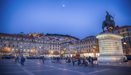 evening Figueira Square,  with a view at bronze  statue of John I , Lisbon , Portugal, mart 2014