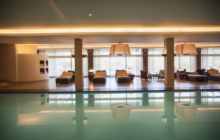 spa swimming pool with relax chairs
