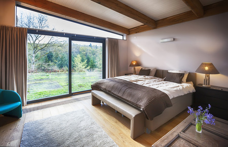 view of a comfortable bedroom: interior of villa in Belgian Ardennes