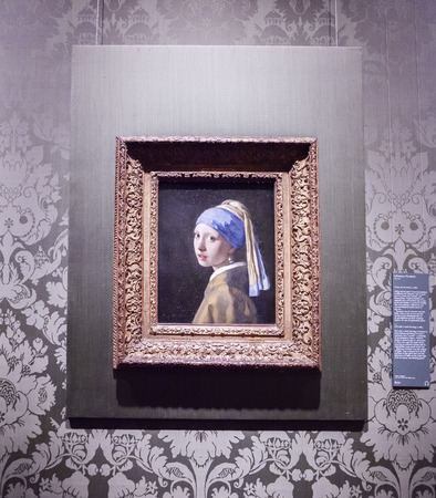 dutch girl: first day official opening of famous Mauritshuis in the Hague after restoration, Johannes Vermeer  Girl with pearl ring    Editorial