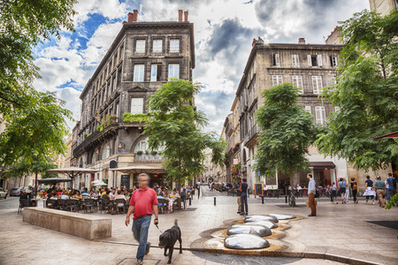 typical street life in Bordeaux in old center