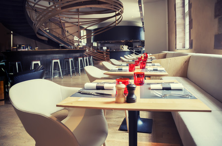 dining table and chairs: designed restaurant in antique old building Stock Photo