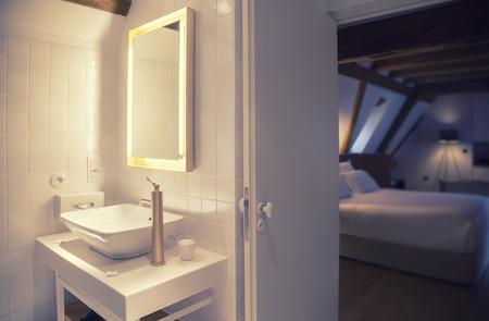 modern bathroom in old hotel photo