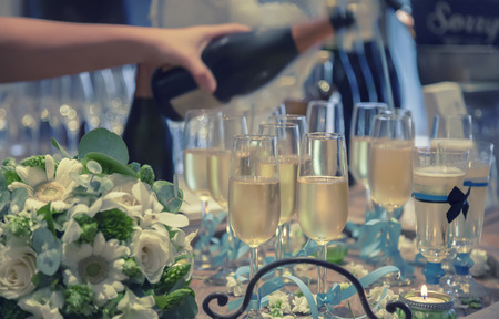 Glasses of champagne and candles: Champagne glasses by wedding party