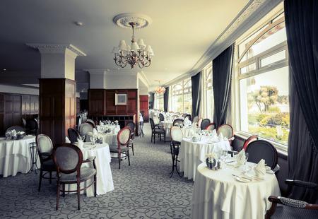 interior of stylish restaurant, evening Фото со стока