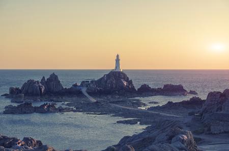Jersey Island, lighthouse Corbiere in evening sunlight