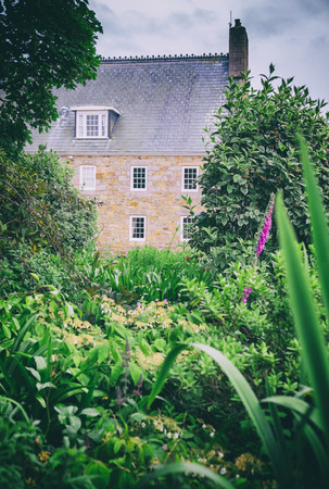 english house: typical English garden and detail of house Stock Photo