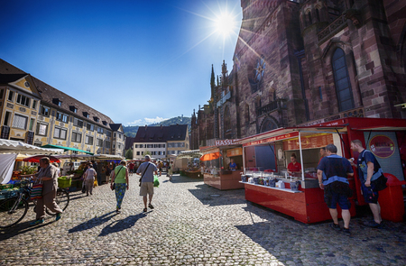 town hall square: Editorial : FREIBURG IM BREISGAU, GERMANY, 07-08-2015: morning market on Town hall square, near central Cathedral, Baden-Wurttemberg state, Germany Editorial