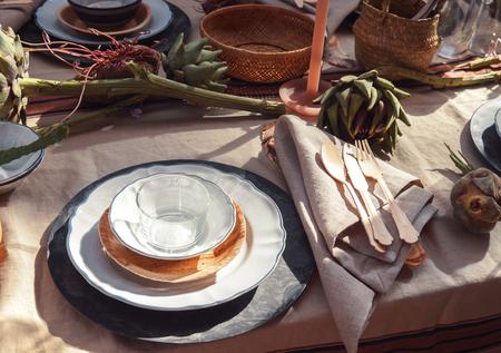 table setting: autumn dinner table in garden