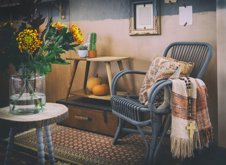 cozy autumn interior with lounge chair
