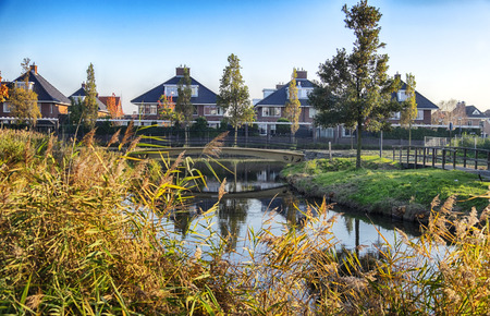 dutch typical: typical Dutch modern village, seasonal image Stock Photo