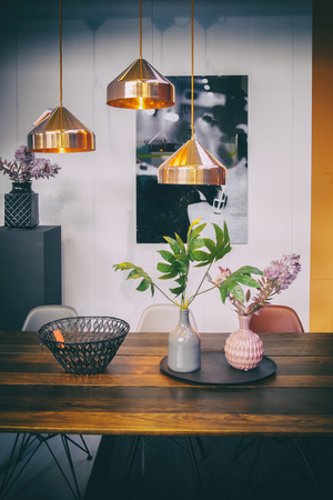 interior with lamps and dinner table in home Stockfoto