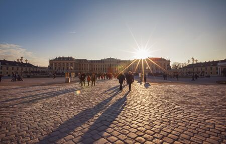 schoenbrunn: winter sun and people at Schoenbrunn Palace square by Christmas market , Vienn,  Austria,  24  December 2015 Editorial