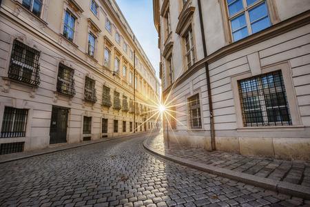 between: winter sun between two buildings in historical center of Vienna