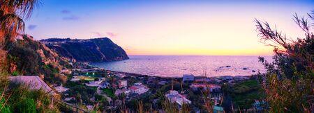 romance sky: panorama of sunset coast  of Ischia island, Italy Stock Photo