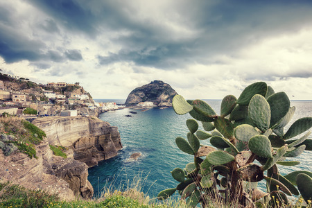 sea cliff: view of Sant Angelo in Ischia island in Italy Stock Photo
