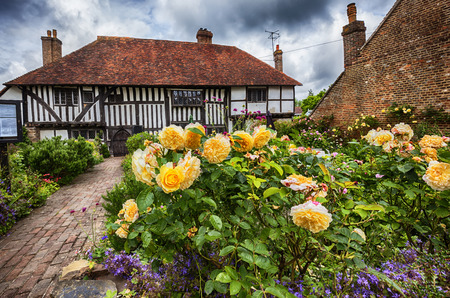 old medieval house and garden  in Battle town , East Sussex,  England Stock Photo
