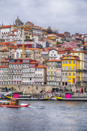view of old historic part of Porto from river Douro Редакционное