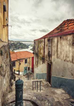 autumn small street in Porto, Portugal Редакционное