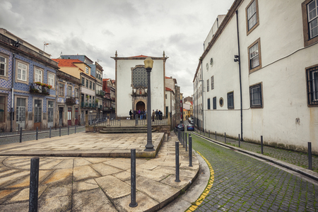street in Porto with local church, Portugal,