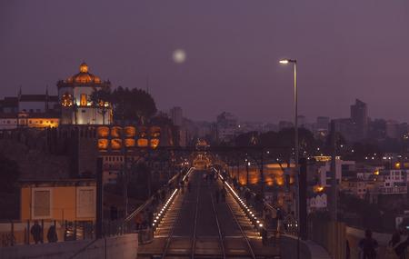 evening panorama at Dom Luis Bridge of Porto, Portugal