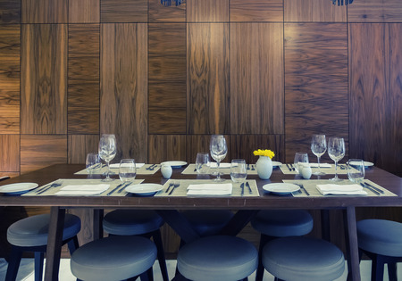 restaurant tables: tables in classic restaurant with background of  wooden wall Stock Photo