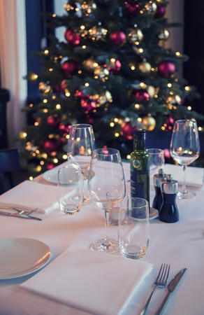 restaurant table and christmas tree as background