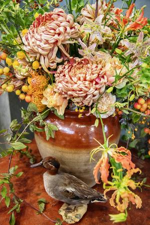 decorative seasonal flowers in vase, bouqette