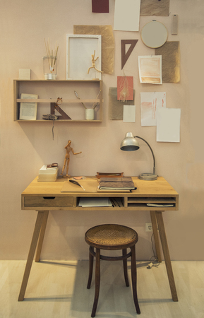 Artist workspace and wooden desk by home