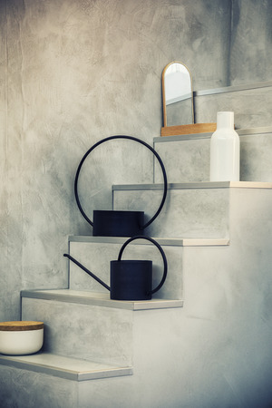 still life with watercans on stair in interior Фото со стока