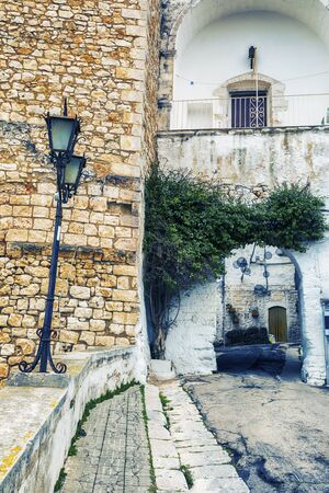 detail of town ancient wall of  Italian city Ostuni in Apulia