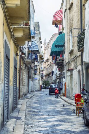 typical street in the old center of Bari on a weekday, region Puglia, Italy