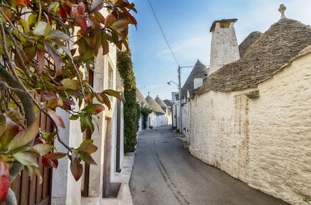 evening view at Alberobello village (town) with gabled (trullo) roofs and white houses, Puglia, Italy