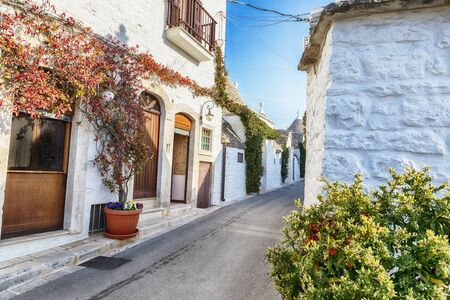 evening street in Alberobello village  with gabled (trullo) roofs, Puglia, Italy 스톡 콘텐츠