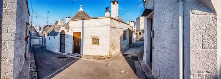 evening panorama of street in Alberobello village  with gabled (trullo) roofs, Puglia, Italy 스톡 콘텐츠