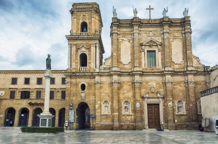 Piazza Duomo with Brindisi Cathedral near Archiological museum, Brindisi, Italy 스톡 콘텐츠