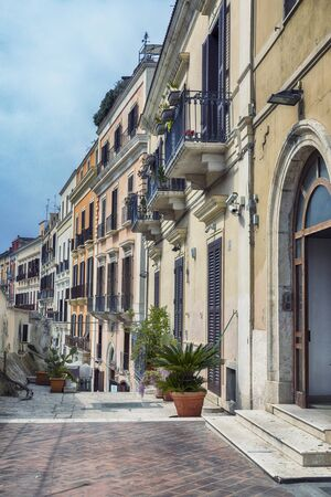 descent down near sea boulevard and Theater Margherita in the old center of Bari near the sea boulevard on a weekday, region Puglia, Italy 스톡 콘텐츠