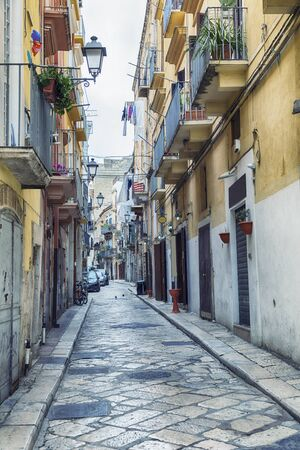 typical street in the old center of Bari near the sea boulevard on a weekday, region Puglia, Italy