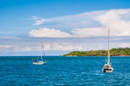 Sailboats anchored in front of the island of Bocas, Panama