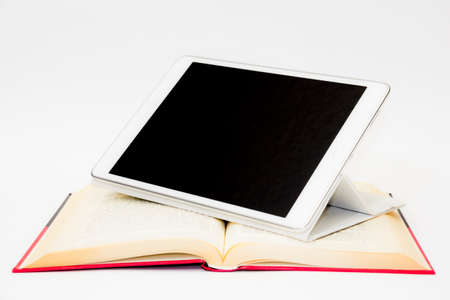 Tablet and book Stock Photo