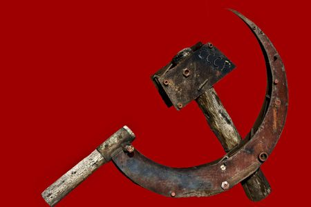 Decayed Hammer And Sickle Standard-Bild