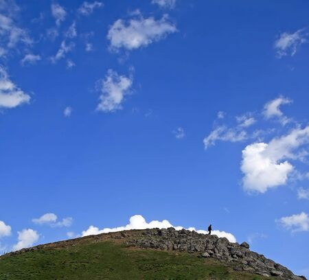 walking man on the top of a hill